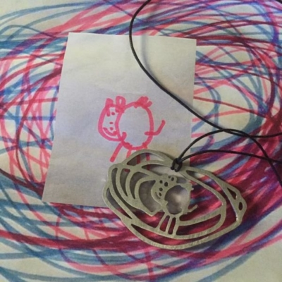Chidls drawing to personalized necklace